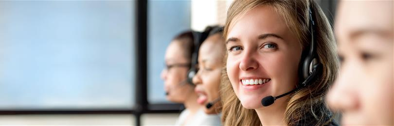 Smiling_Contact_Center_Representatives_With_Headset